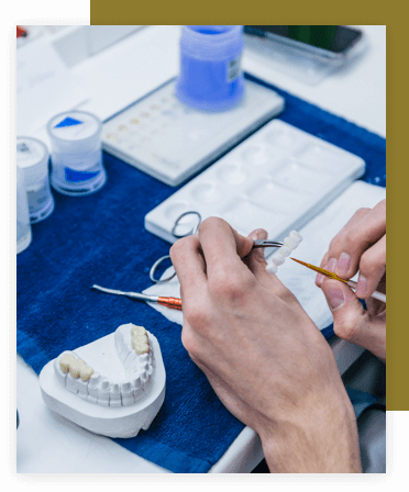 Dental technician creating a dental bridge